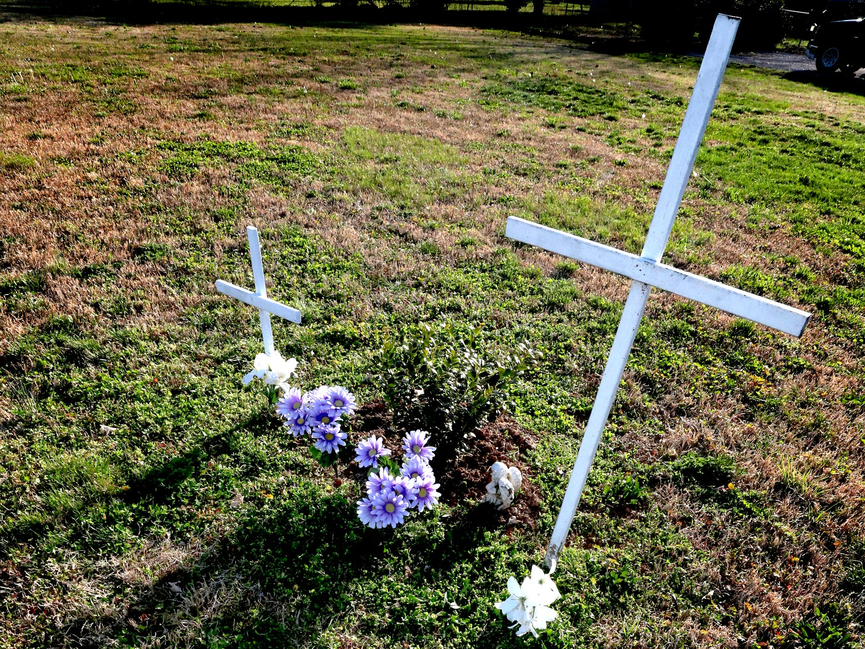 Two wooden crosses are on a plot of land at the corner of Sulphur Springs Road and Haynes Drive on Wednesday March 27, 2019, to remember 9 week-old Olivia Bryant and her mom Kori Bryant who, died due to the 2009 Good Friday tornado. The site marks the location of the house that was destroyed ten years ago where the two died in 2009.