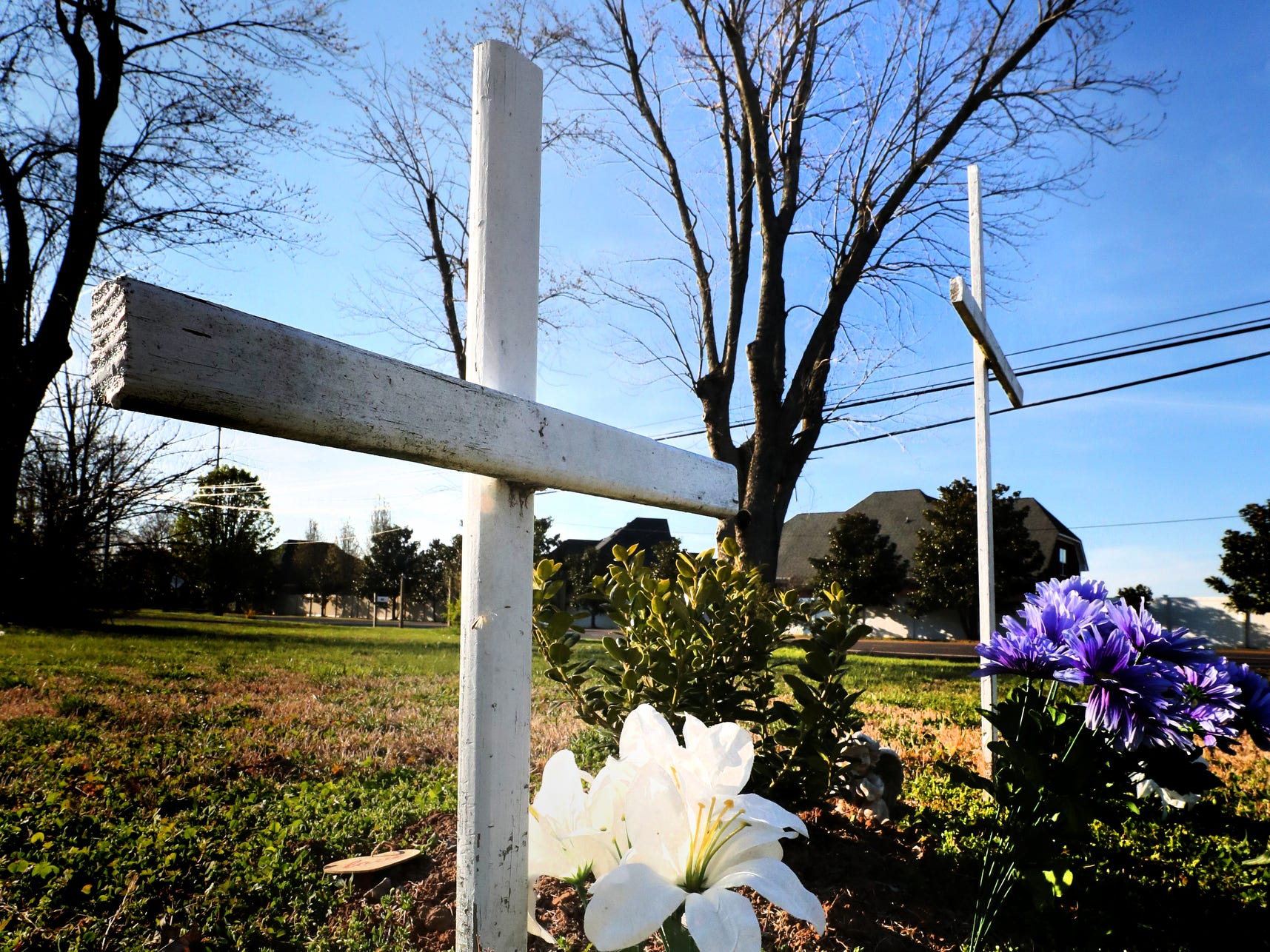 Two wooden crosses are on a plot of land at the corner of Sulphur Springs Road and Haynes Drive on Wednesday March 27, 2019, to remember 9 week-old Olivia Bryant and her mom Kori Bryant, who died due to the 2009 Good Friday tornado. The site marks the location of the house that was destroyed ten years ago where the two died in 2009.