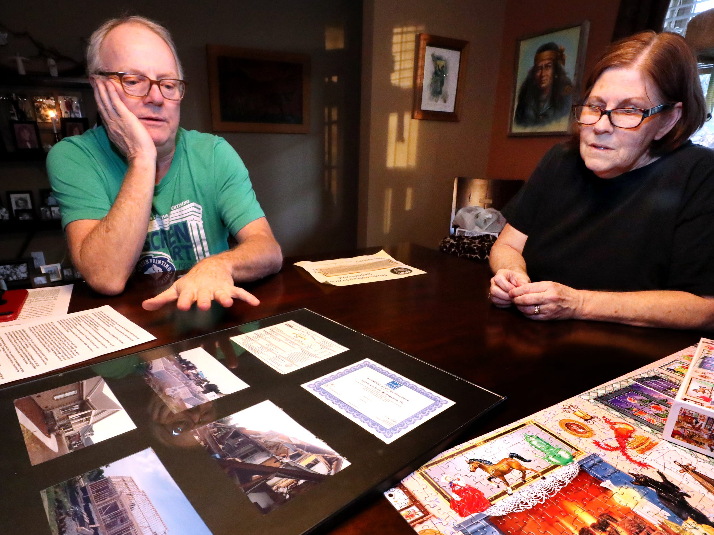 Mike and Teresa Bickford show off pictures and items that they acquired after the 2009 Good Friday tornado destroyed their home, during an interview in their new home, on Wednesday March 27, 2019.