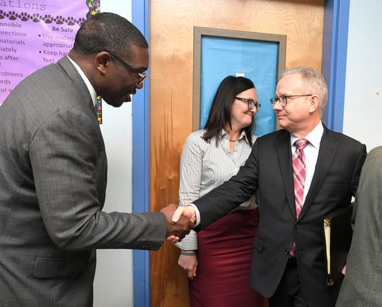 Mayor David Briley, right, shakes hands with Metro Schools Director Shawn Joseph after Briley held a news conference Friday, March 29, 2019, at Napier Elementary School to address school board turmoil.