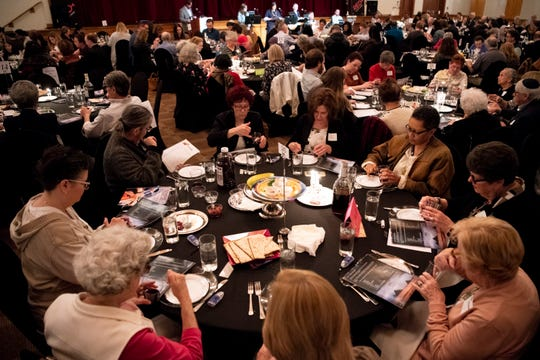Guests participate in the Stronger Than Hate Seder at the Gordon Jewish Community Center in Nashville, Tenn., Thursday, March 28, 2019.