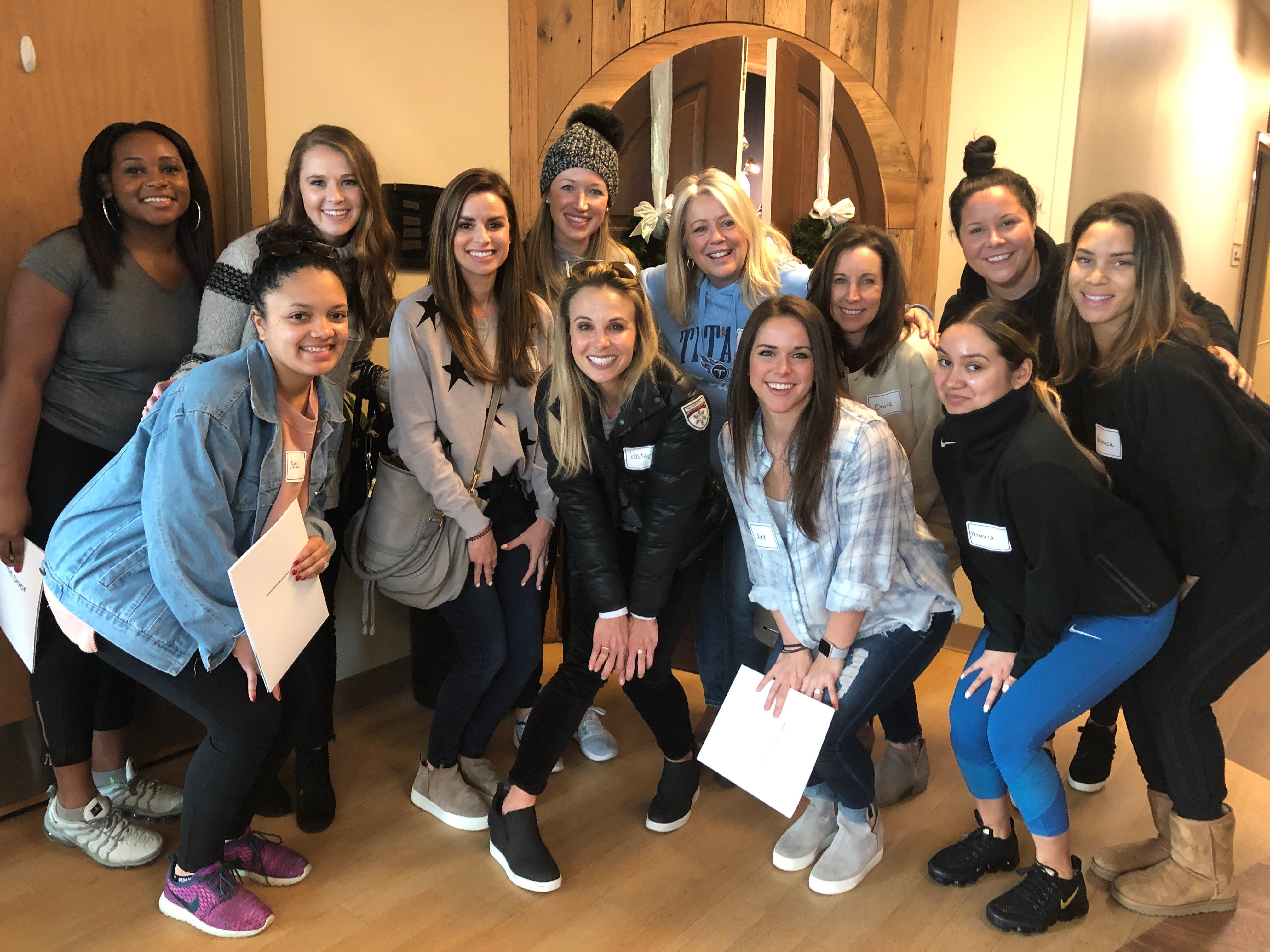 Elisabeth Hasselbeck, front and center, joins Titans' wives and players in a visit to The Next Door, a residential rehab program for women in addiction in Nashville