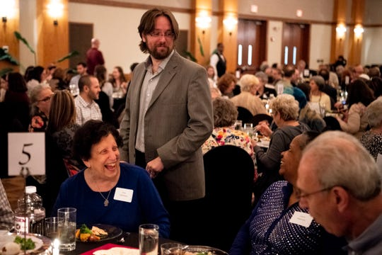 Rabbi Joshua Kullock, of West End Synagogue, greets guests during the Stronger Than Hate Seder at the Gordon Jewish Community Center in Nashville, Tenn., Thursday, March 28, 2019.