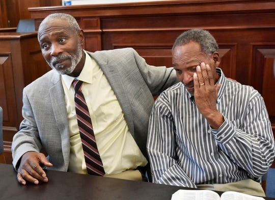 Nathan Myers, left, embraces his uncle, Clifford Williams, during a news conference after their 1976 murder convictions were overturned Thursday, March 28, 2019 in Jacksonville, Fla. The order to vacate the convictions originated from the first ever conviction integrity review unit set up by State Attorney Melissa Nelson.