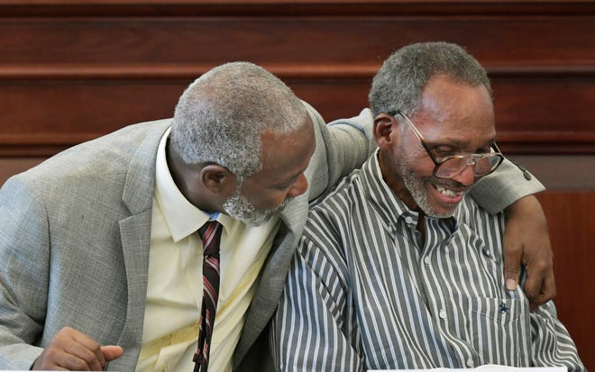 Nathan Myers, left, hugs his uncle, Clifford Williams, during a news conference after their 1976 murder convictions were overturned Thursday, March 28, 2019 in Jacksonville, Fla. The order to vacate the convictions originated from the first ever conviction integrity review unit set up by State Attorney Melissa Nelson.