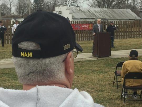 A Vietnam veteran listens as Pataskala Mayor Mike Compton speaks.