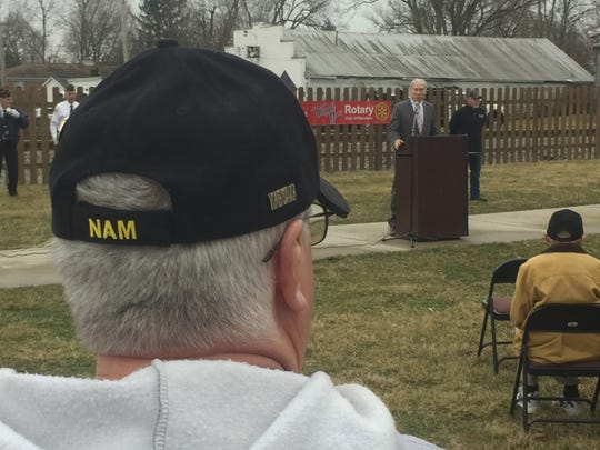 A Vietnam veteran listens as Pataskala Mayor Mike Compton speaks.