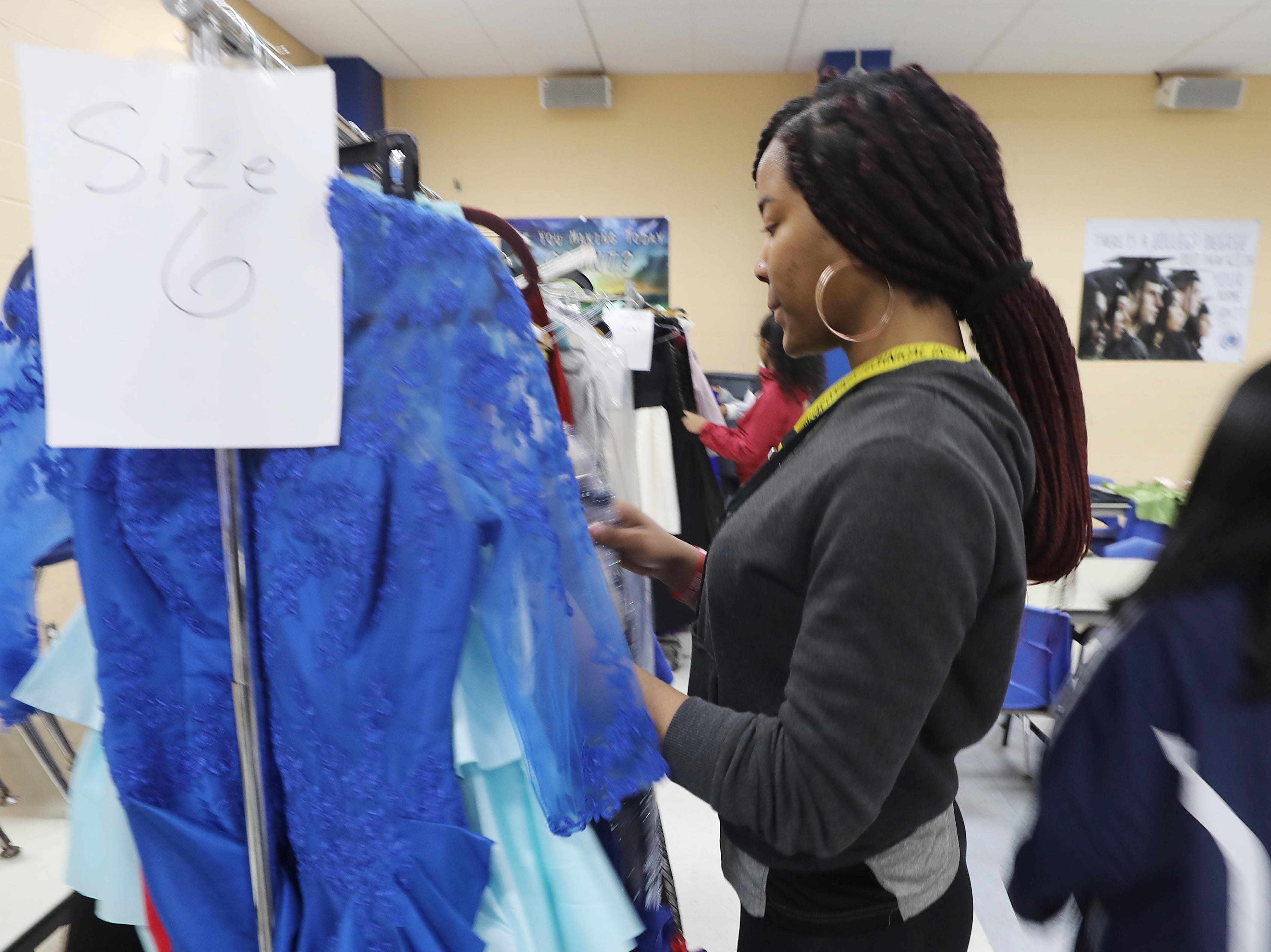 Imani Durham of Paterson is looking for a dress at the annual Prom Gown Giveaway held at Passaic County Technical Institute.