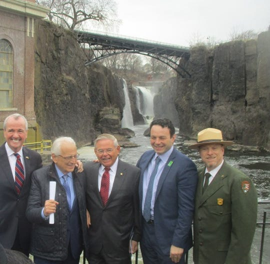 Gov. Phil Murphy, left, stands with Rep. Bill Pascrell, Sen. Bob Menendez, Paterson Mayor Andre Sayegh and park superintendent Darren Boch at the Great Falls on Friday.