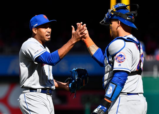 Mar 28, 2019; Washington, DC, USA; New York Mets relief pitcher Edwin Diaz (39) is congratulated by New York Mets catcher Wilson Ramos (40) after earning a save against the Washington Nationals at Nationals Park. Mandatory Credit: Brad Mills-USA TODAY Sports