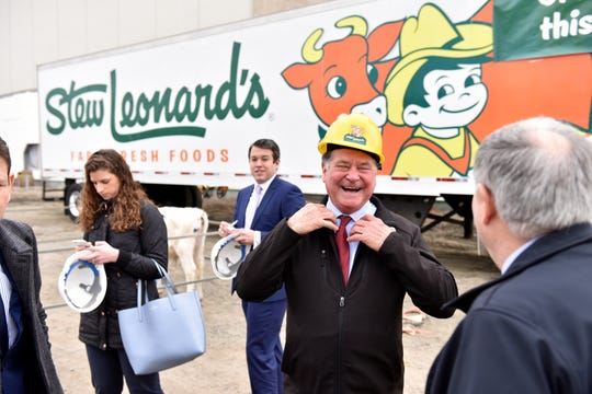 Stew Leonard Jr., CEO, talks with Bergen County Executive James Tedesco at the ground breaking. Stew Leonard's held a ground breaking at Paramus Park Mall in Paramus on Friday March 29, 2019. There were three calves brought and champagne flutes filled with milk to toast the occasion.