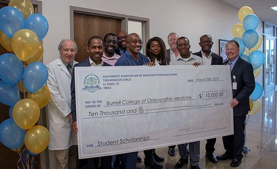 Members of the Southwest Association of Nigerian Physicians present a check for $10,000 to leadership at BCOM. Photo credit: Burrell College of Osteopathic Medicine.