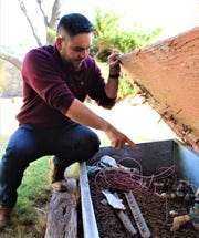 Las Cruces City Councilor Gabriel Vasquez, District 3, points out the leaky sprinkler valve that was the root of his water leak. If your water bill spikes, it could be an indication of a non-obvious water leak. Call customer service at 541-2111 to have it checked out.