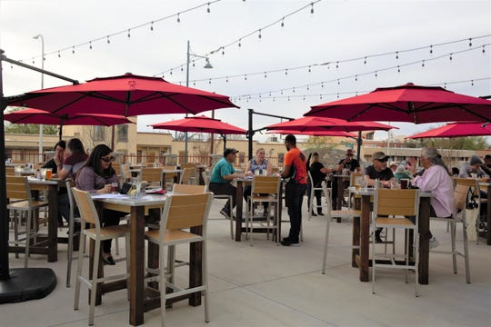 Residents enjoy a few beers and food at The Broken Spoke Taphouse courtyard at The Amador, 302 S. Main St., Wednesday, March, 27.