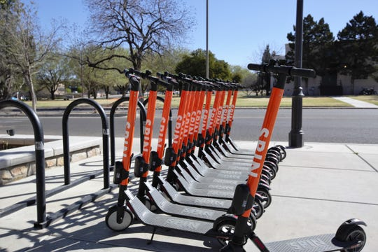 Spin battery-operated kick scooters available for service on the main campus of New Mexico State University, March 29, 2019.