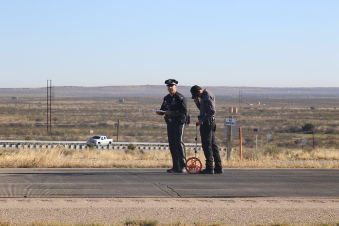 New Mexico State Police investigate an accident in late March on U.S. highway 285 and the George Shoup Relief Route.