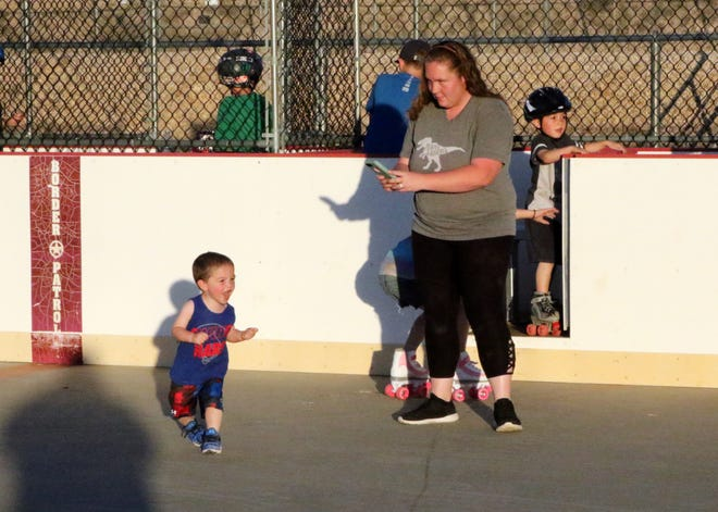Boston Brake dances to Queen's Another One Bites the Dust while his mother, Chrisann Brake, videotapes his moves during Thursday's Skate Night at the Carlsbad Riverwalk Recreational Complex.