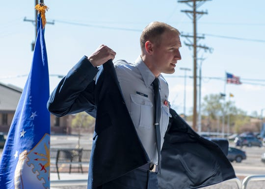 Staff Sgt. John-Paul Nance, 49th Medical Group Public Health technician, puts on his service coat, March 22, at his commissioning ceremony on Holloman Air Force Base, N.M. Nance's final day on Holloman, March 29, will be his first day as a commissioned officer.
