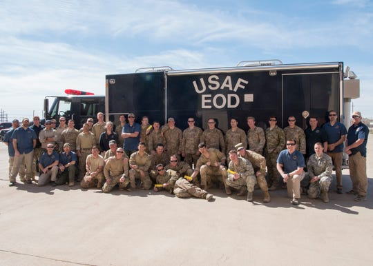 Airmen from five Explosive Ordnance Disposal shops across the Air Force, members of Doña Ana County Police Department's bomb squad and instructors from the Bureau of Alcohol, Tobacco, Firearms and Explosives' National Center for Explosives Training and Research pose for a picture, March 22, 2019, on Holloman Air Force Base, N.M. The group finished the ATF's NCETR post-blast course.