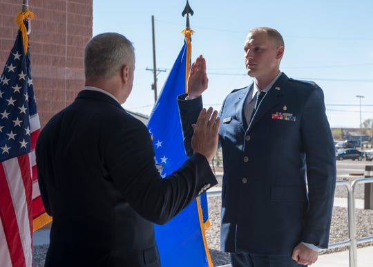 Staff Sgt. John-Paul Nance, 49th Medical Group Public Health technician, raises his right hand and recites the Oath of Office, read to him by his uncle, retired Lt. Col. Joseph Miller, March 22, 2019, on Holloman Air Force Base, N.M. Growing up surrounded by generations of service members, Nance was driven to serve his country from a young age.