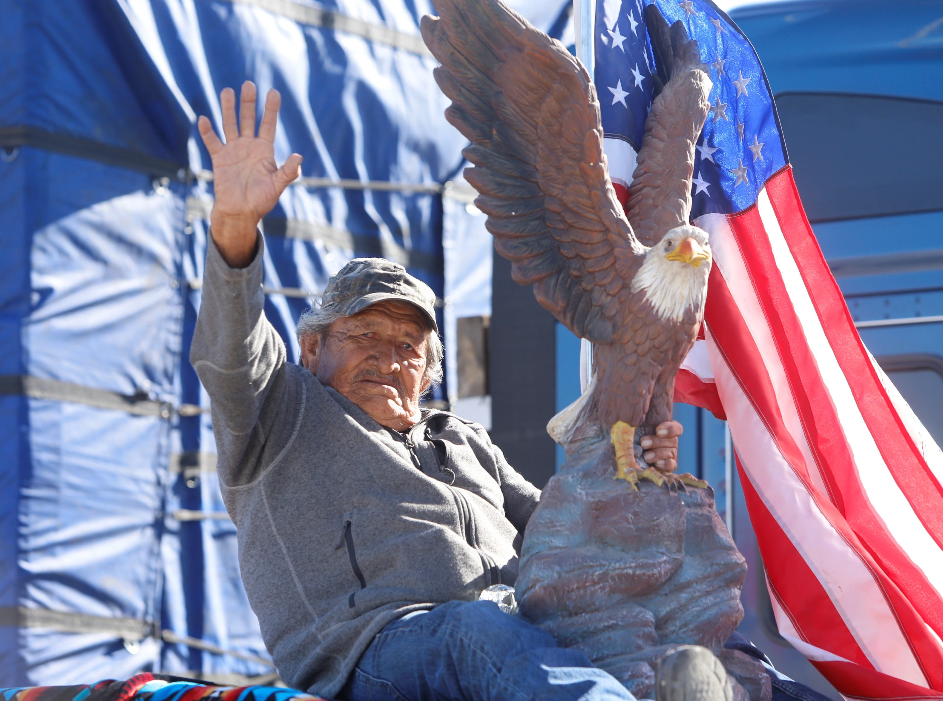 San Juan Chapter member Hoskie Yazzie honors the military service of his three brothers during the Vietnam Veterans Day parade on Friday in Shiprock.