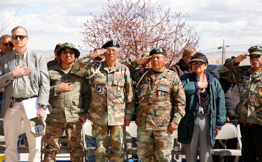 Second from left, Vietnam veterans Danny Clyde, Robin Wood and Leonard Pablo Sr. stand during the national anthem on Friday at the Vietnam Veterans Day event at the Northern Navajo Veterans Center in Shiprock.