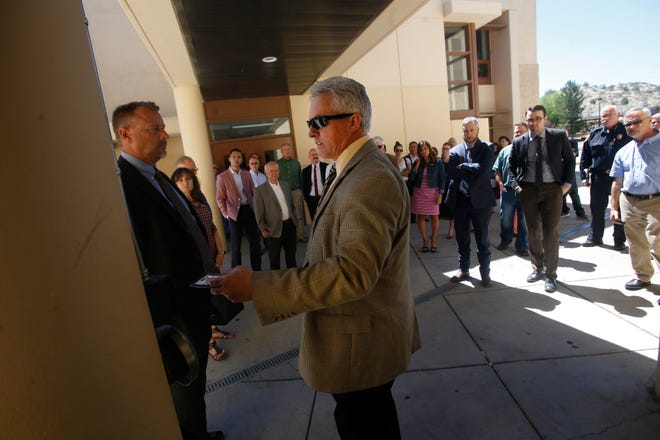 Aztec Municipal School District Superintendent Kirk Carpenter leads a tour, Tuesday, June 19, 2018 of Aztec High School for members of the Legislative Education Study Committee. A hearing officer recommended notices to revoke his licenses as an educator be dismissed.