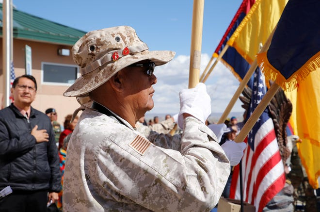Upper Fruitland Color Guard member and Marine Corps veteran Alvis Kee holds the United States flag on Friday at the Vietnam Veterans Day welcome home ceremony at the Northern Navajo Veterans Center in Shiprock.