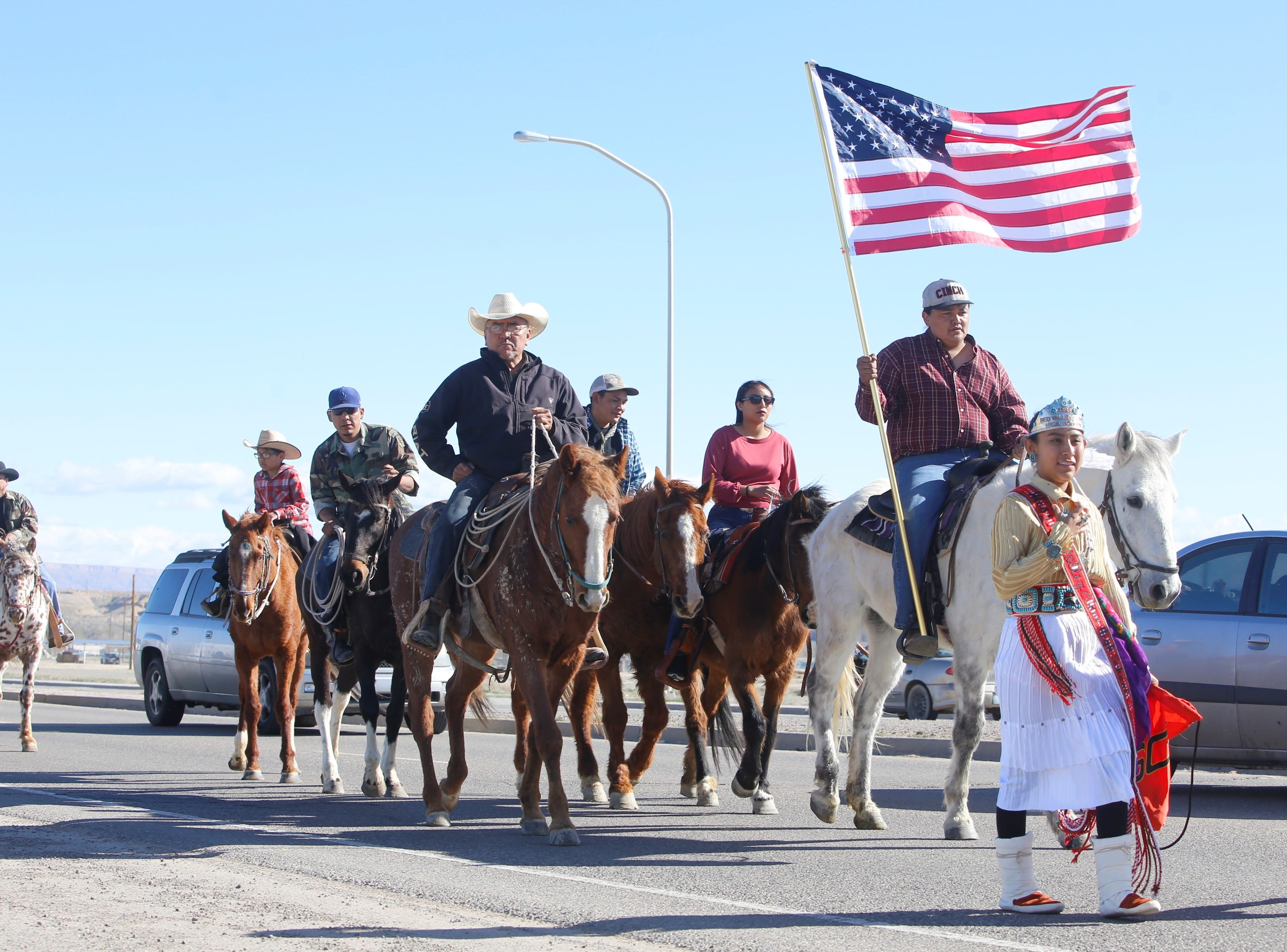 Participants in the Vietnam Veterans Day parade proceed south on U.S. Highway 491 in Shiprock on Friday.