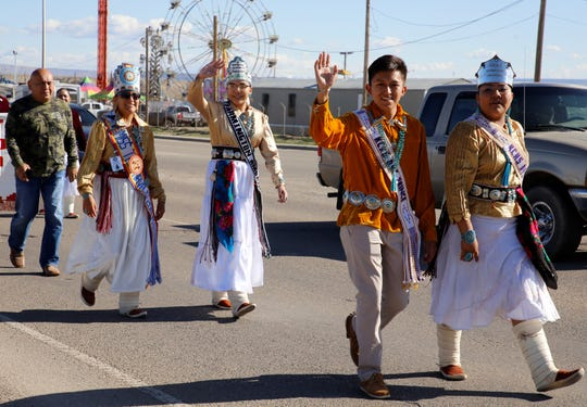 Farmington American Indian Ambassador Nikeisha Kee, third from left, waves to spectators on Friday during the Vietnam Veterans Day parade in Shiprock.