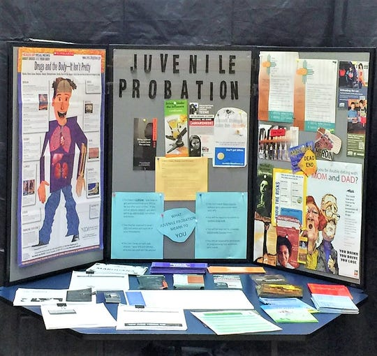 A booth providing information to teens about what can happen if they are ever convicted of a crime, where they end u[p and what psychological effects it can have of immediate family members and friends. They encourage the youth to think before doing anything they will regret forever.