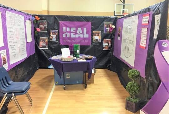 HEAL provided information and photos of people that have been victims of abuse. Their misiion is to raise awareness to help end abuse.