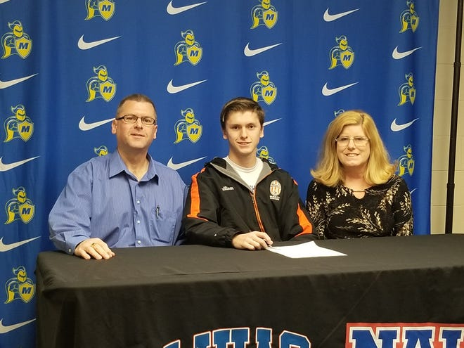Northville's Sean Sullivan is pictured with his parents after signing to play soccer at Madonna.