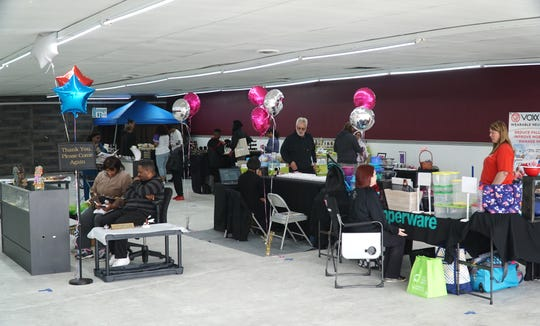 Shoppers check out a variety of vendors' tables at the Westland Mini Mall on March 29.