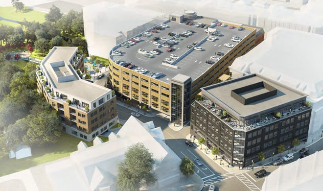 A rendering of what the new North Old Woodward parking structure and related development site planned by Woodward Bates Partners could look like in Birmingham. The proposed project adds more than 400 parking spaces, retail, housing and extends Bates Street.