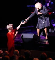 Nancy Stone and Patti LaBelle exchange shoes