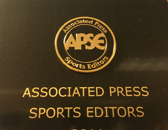 An Associated Press Sports Editors first-place plaque