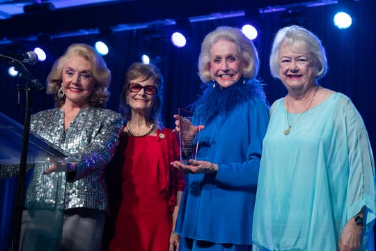 Nelda Linsk, third from left, receives a Lifetime Achievement Award. Standing next to her are Peggy Cravens, left; Norma Greer Fishkind, second from left; and Suz Hunt, right.