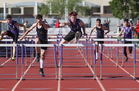 Dylan Francis of Shadow Hills, center, wins the 110 meter hurdle against La Quinta runners during their meet in Indio, March 28, 2019.