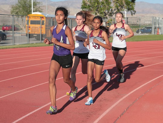 Nyah Chavez of Shadow Hills leads the pack in the girls 3200 meter event in Indio, March 28, 2019.