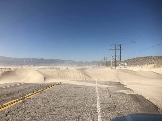 A three-foot high sand embankment has closed Indian Canyon Drive between Tramview Road and Interstate 10.