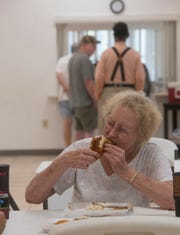 Bobbie McKay enjoys her lunch provided by the Council on Aging of West Florida at the Bagdad Community Center on Friday.