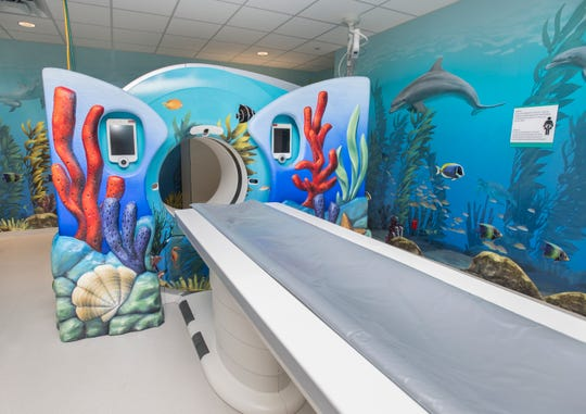 The CT room at Sacred Heart's new Studer Family Children's Hospital in Pensacola has an underwater theme intended to make the space friendly for children and families.