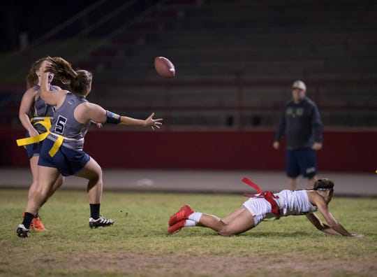 Kaylie Herring (5) tries to intercept the ball after Katie Brabham (11) couldn't make a diving catch during the Gulf Breeze vs Pace flag football game at Pace High School on Wednesday, March 27, 2019.
