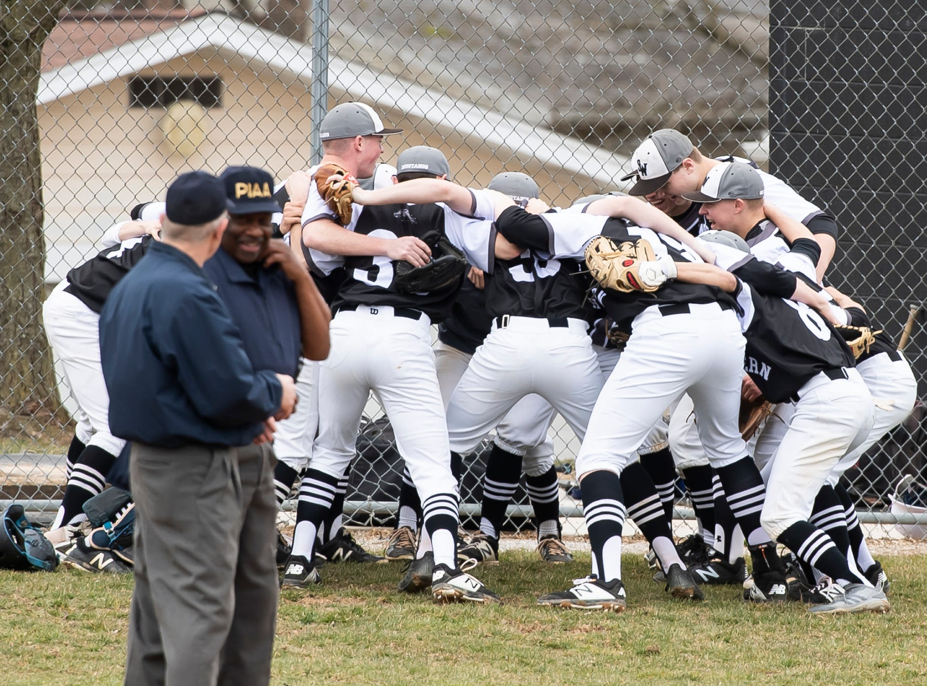 The South Western Mustangs get pumped up before a baseball game against Carlisle at home on Friday, March 29, 2019. The Mustangs won 11-9.