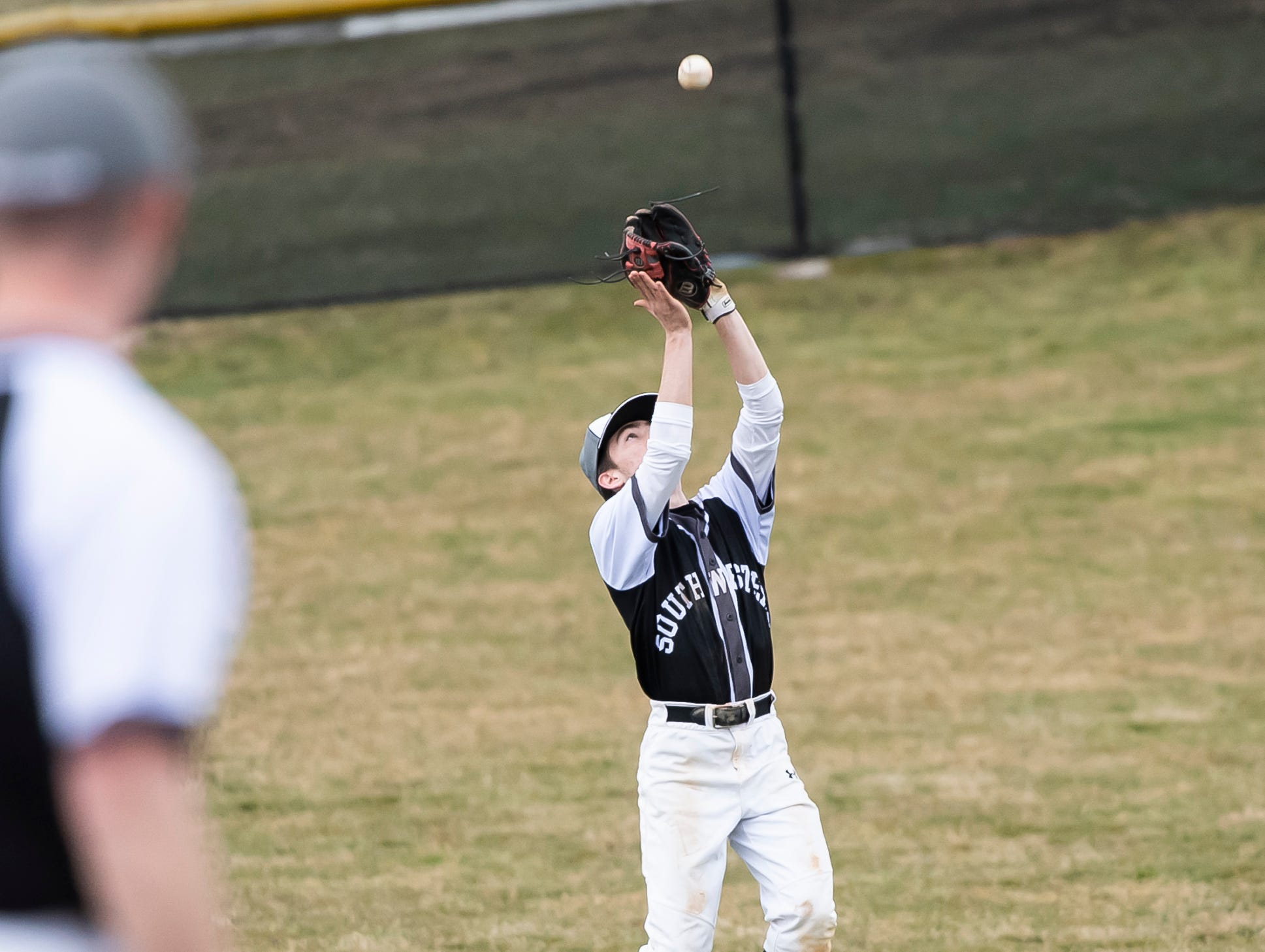 South Western's Alex Klingler prepares to catch an infield fly during play against Carlisle in Hanover on Friday, March 29, 2019. The Mustangs won 11-9.