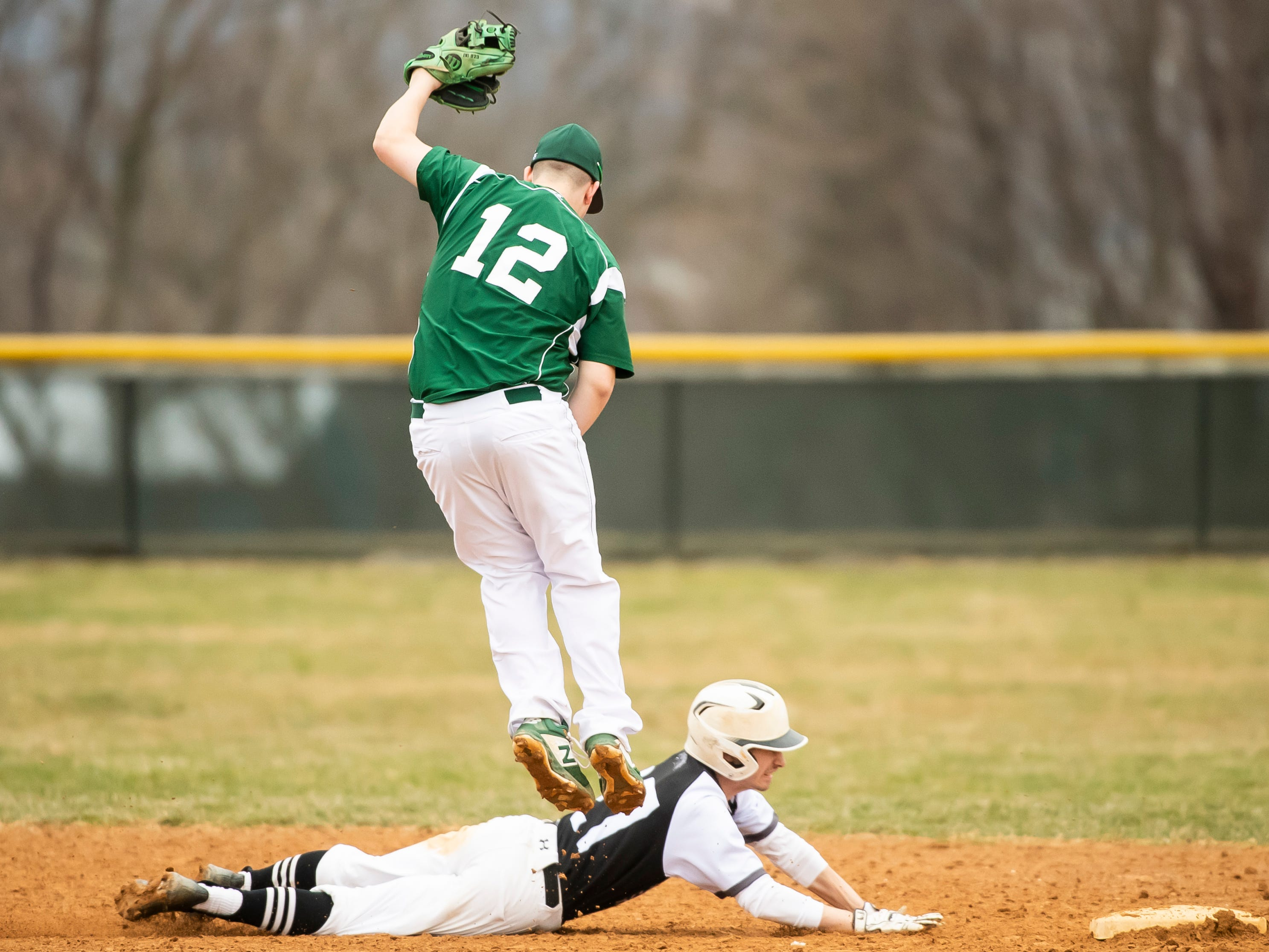 South Western's Alex Klingler dives safely back into second base during a game against Carlisle in Hanover on Friday, March 29, 2019. The Mustangs won 11-9.