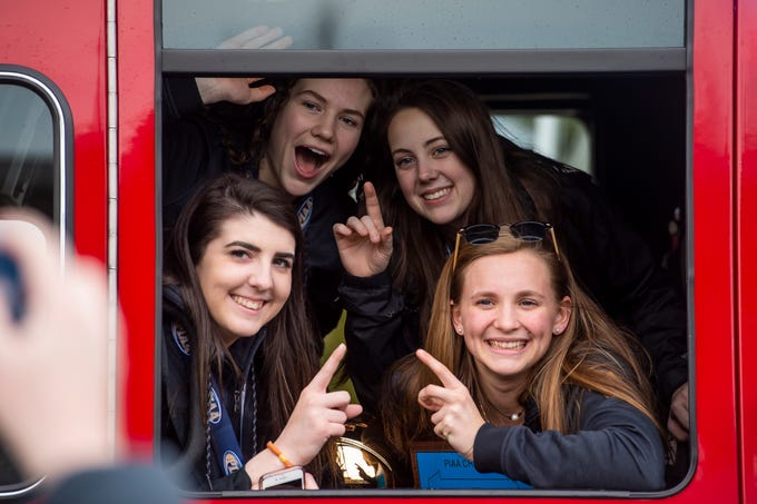 (Clockwise from bottom left) Delone Catholic seniors Bradi Zumbrum, Ashley Becker, Dee McCormick and Riley Vingsen pose for photos inside a firetruck before the start of a parade in McSherrystown celebrating their PIAA championship on Thursday, March 28, 2019. The Squirettes defeated previously unbeaten Dunmore 49-43 on March 21, 2019.