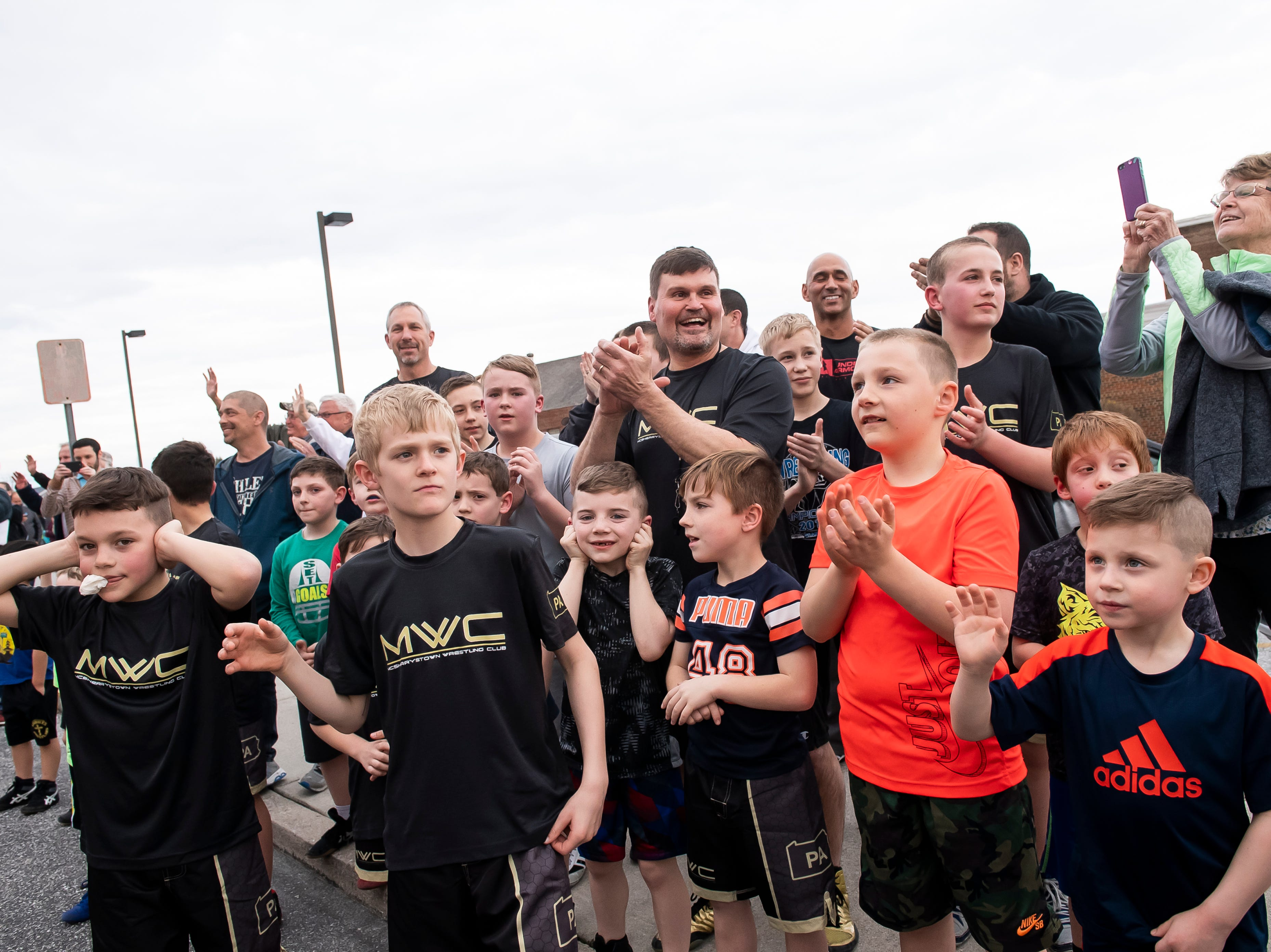Delone Catholic fans young and old cheer for the Squirettes during a parade in McSherrystown celebrating their PIAA championship on Thursday, March 28, 2019.