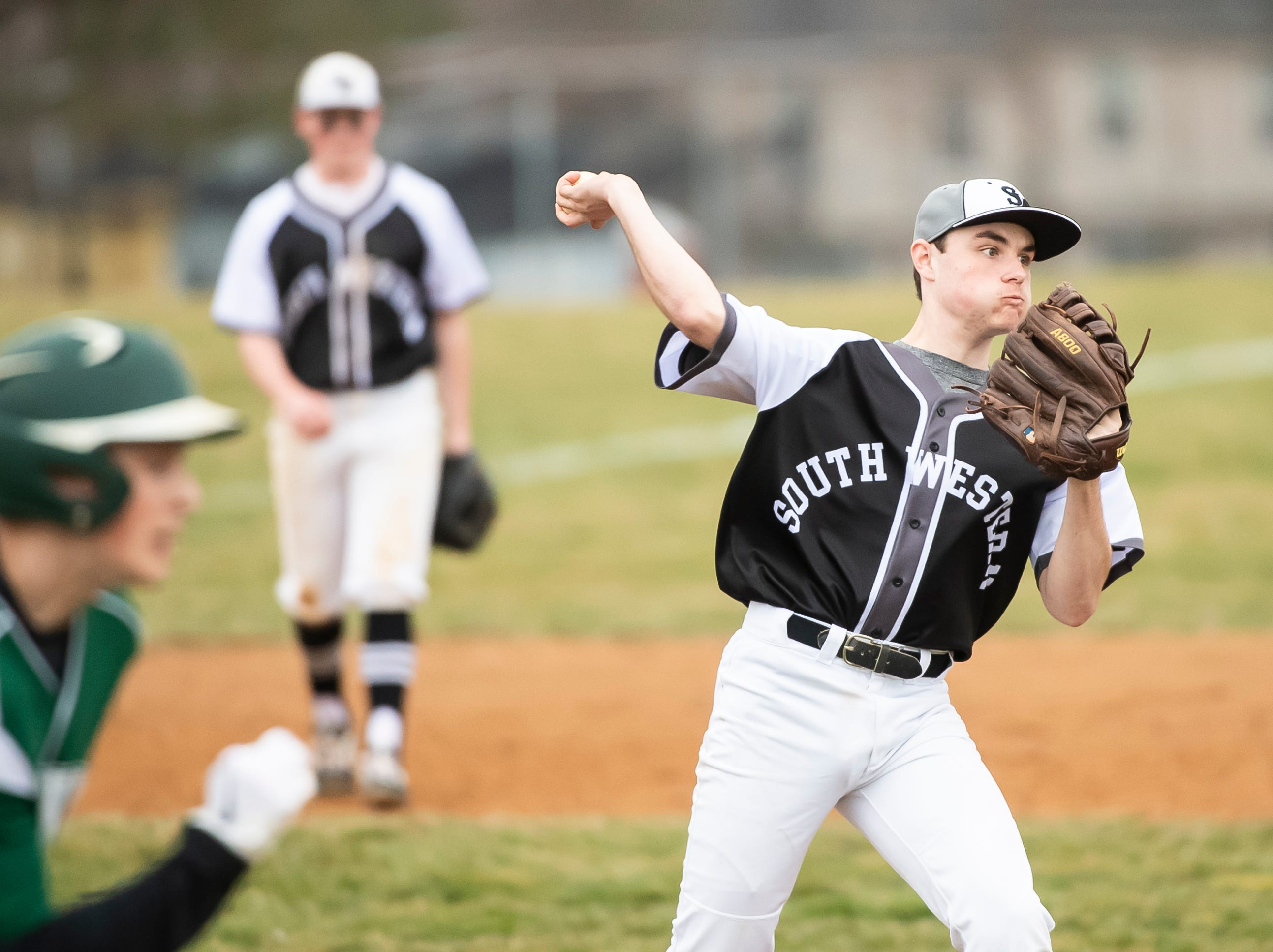 South Western pitcher Zachary Weaver throws the ball to first to record an out during a game against Carlisle in Hanover on Friday, March 29, 2019. The Mustangs won 11-9.
